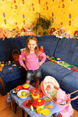 Little girl playing with toys in her room — Stock Photo