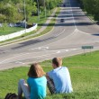 Stock Photo: Pair young enamoured near road