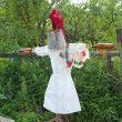 Motley scarecrow in white docktor's smock — Stock Photo #30623789