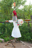 Motley scarecrow in white docktor's smock — Stock Photo