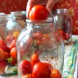 Tomatos in jars prepared for preservation — Stock Photo #30640575