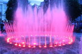 Colored fountain in city park — Stock Photo