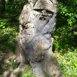 Stock Photo: Sculpture of fabulous personage cut out from tree