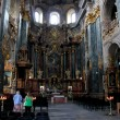 People in magnificent churche of Lvov — Stock Photo