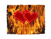Pair of red symbolic hearts in the flame — Stock Photo