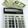 Dollar bank notes, calculator and pen — Stock Photo