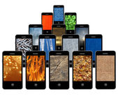 Mobile phones with different abstract textures — Stock Photo