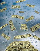 Dollar banknotes lying on the wet glass — Stock Photo