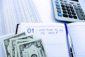 Writing down in a notebook about a debt — Stockfoto