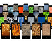 Modern mobile phones with different textures — ストック写真