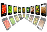 Mobile phones with images of different vegetables — Stock fotografie