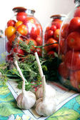 Tomatos in jars prepared for preservation — Stock Photo