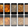 Modern mobile phones with different textures — Stockfoto