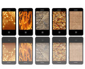 Modern mobile phones with different textures — Stock Photo
