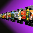 Modern mobile phones with different images — Stok fotoğraf