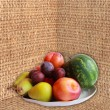 Stock Photo: Watermelon, pears and plums on sacking
