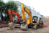 Two modern excavators working on the Lvov's street — Stock Photo