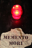 Candle and inscription in Latin memento mori — Stock Photo