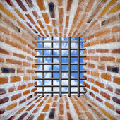 Prison's window and bars in wall from brick — Stock Photo