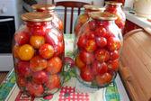 Tomatos in jars prepared for preservation — Stock Photo