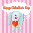 Vector cute cartoon bunny holding heart. — Stock Vector #19320867