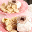 Стоковое фото: Ice cream with grated chocolate and slices of banana: two portions