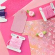 Pastel pink and purple card making composition: threads, craft paper, craft elements — Stockfoto