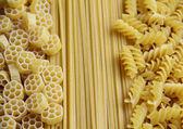Three types of uncooked (raw) pasta (macaroni): spaghetti, fusilli and fiori — Stock Photo