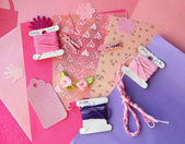 Pastel pink and purple card making composition: threads, craft paper, craft elements — Stock Photo