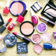 Make up assortment: lipsticks, nail polishes, blusher, eye shadows, foundation and powder of different colours — Foto de Stock