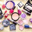 Make up assortment: lipsticks, nail polishes, blusher, eye shadows, foundation and powder of different colours — Stok fotoğraf