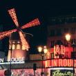Stock Photo: The Moulin Rouge by night