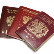 Three different passports isolated on white - Stock Photo