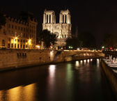 View at Latin Quarter and river Seine at Night from Cite, Paris city centre. — Stock Photo