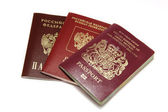 Three different passports isolated on white — Stock Photo