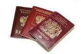 Three different passports isolated on white — Stock Photo