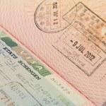 Close up shot of Schengen visa and Hong Kong visa in a passport — Stock Photo
