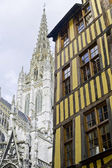 Rouen - Exterior of ancient house and church — Stock Photo