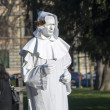 Man disguised and painted in white -  