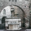 Stock Photo: Perugi- Old fountain and arch