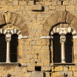 Постер, плакат: Volterra Pisa Two mullioned windows