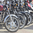 Постер, плакат: Motorcycles costing in row