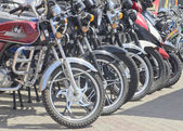 Motorcycles costing in row — Stock Photo