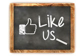 "Blackboard showing ""Like us"" as used in social networks — Stock Photo"