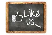 "Blackboard showing ""Like us"" as used in social networks — Stock Photo"