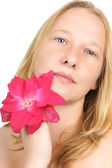 Portrait of a pretty blonde woman with flower — Stock Photo