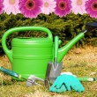 Garden tools with gerbera frame — Stock Photo