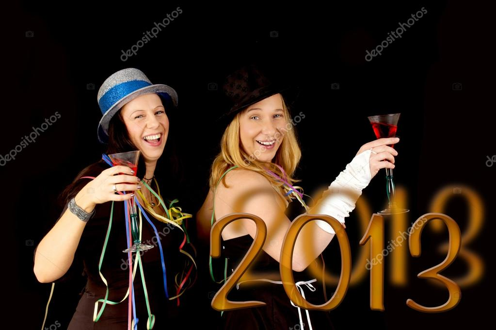 Two pretty woman with champagne glass celebrate new year's eve — Stock Photo #17466281