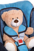 Teddy in the car seat — Stockfoto