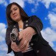 Woman with handgun — Stock Photo #23198878